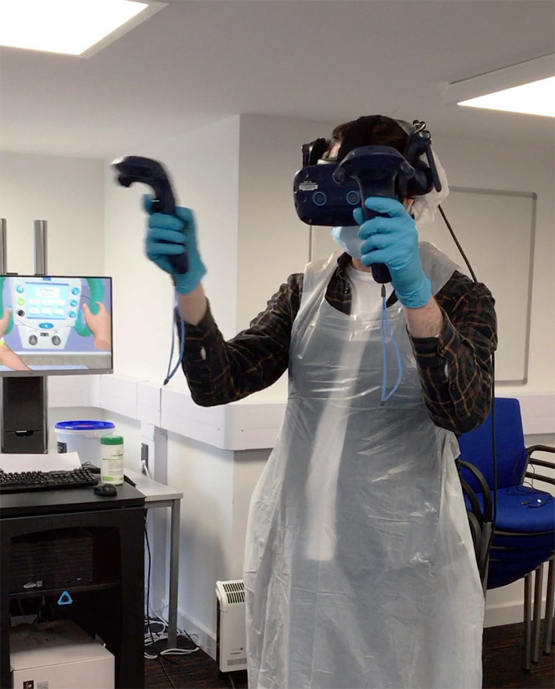 student trying out the VR equipment